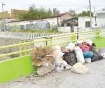 Convierten zona del riel en basurero