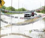 Sigue inundado Boulevard Oriente pero está bajando