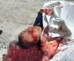 Muere motociclista aplastado por camión materialista