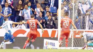 Puebla rescata empate