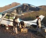Frenan avioneta cargada con drogas