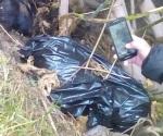Hallan bolsas con restos humanos