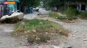 Urgen reparación de calle Principal