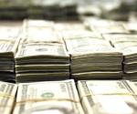 Cae dólar a menor nivel en 14 meses