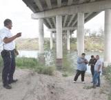 Intensa movilización por un bulto en el río