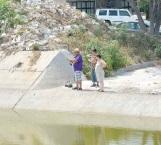 Aprovechan asueto para salir a pescar al Rodhe
