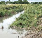 Paralizan lluvias trabajos de desazolve en dren