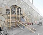 Reparan paredes del paso a desnivel número 2