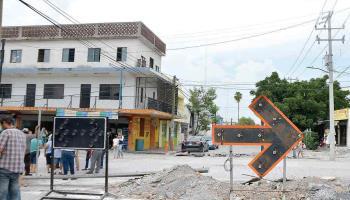 Amenazan comerciantes reabrir calle