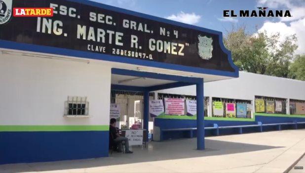 Conflicto y carteles en escuela secundaria