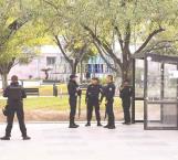 Policías en la mira de pistoleros