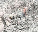 Hallan cuerpos enterrados