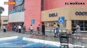 Largas filas realizan en centros comerciales